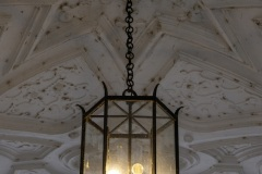 Hanging lamp from iron and glass in the decorated vaulted ceiling in the entrance to the Schloss Johannisburg in Aschaffenburg, the famous historic city castle, selected focus, narrow depth of field