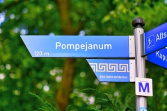 Aschaffenburg, Germany - July 2020: Road sign pointing to 'Pompejanum', an idealised replica of a Roman villa from Pompeji